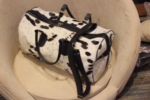cowhide luggage bag