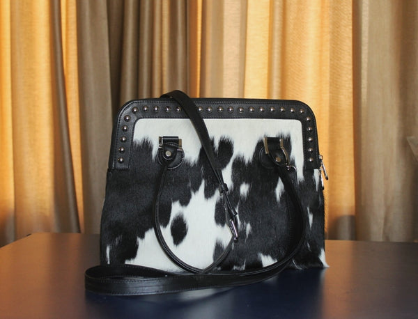 black and white cowhide western sling purse