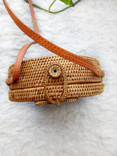 large round straw bags