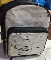 If you have your eye on a cow skin bags nz we hundreds of patterns in stock trending from diaper bag to mommy bags to tote purse.