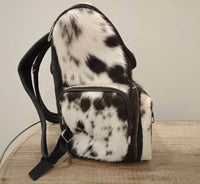 A unique dark brown and white etsy cowhide bag, it 3 side hair on cowhide, genuine plain leather on the back Inside Fully line Zip Compartment inside