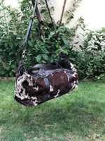 All our cowhide duffle bags in dark reddish brown and black are free shipping worldwide.