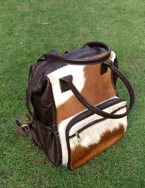 Stunning western cowhide diaper bag in genuine cow fur, fee shipping worldwide this cowhide bag takes one week to complete but worth the wait