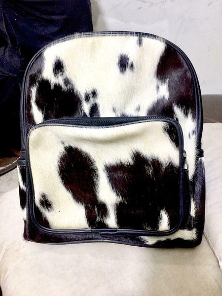 This cow skin back pack is can be use this both for work fits Macpbook perfectly along with other items, this is a quality bag that will last you a very long time.