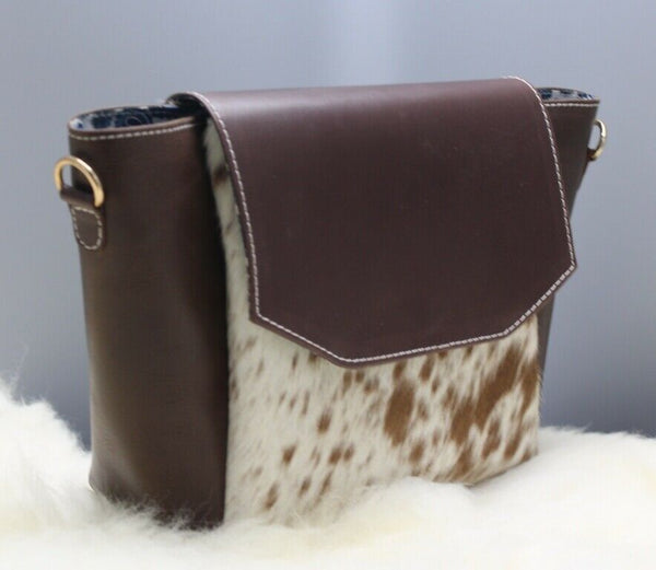 Featuring our new amazing speckled womens cowhide handbag with the touches of black, white and brown with premium leather and adjustable strap.