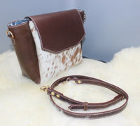 This season women cowhide purse in western rodeo style is perfect for shoulder or for new mommies, spacious enough to carry your weekender stuff