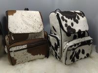 You will receive cowhide travel bag finished with very sturdy material and roomy enough, you can use it from travel as purse or shopping tote