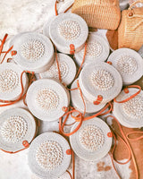 round rattan bag with sea shell decoration