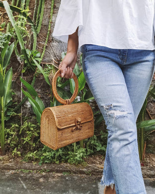woven rattan clutch bag street level