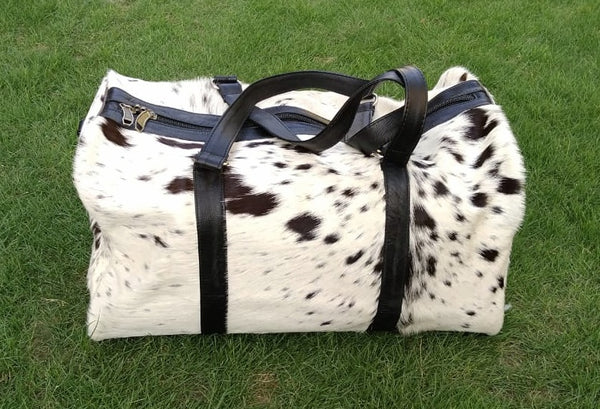 cow skin luggage bag