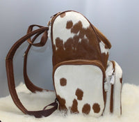 Are you a fan of rodeo check out our cowhide mommy backpack in spotted pattern, this bag for sale is one you need as shopper bag.