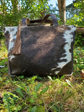 a unique ranch cowhide purse in crossbody messenger bag