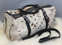 If you are searching for over sized cowhide travel bag this is perfect for laptop or shopper, its free fast shipping and made from cow fur.