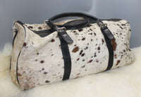 A large cowhide travel tote bag is great for work, school, leisure, shopping, travel this spotted cow fur leather bag can easily hold all your travel gear