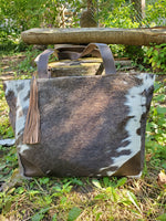 A messenger bag made from real cowhide for western style
