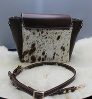 A cow fur purse for ladies made with durable leather and real hair on cowhide with adjustable strap and handles, this fur purse is perfect for any weekend or shopper.