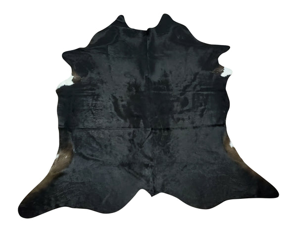 A small black cowhide rug that looks really pretty and cute, works just fine for any space or home office decor.