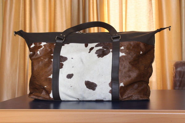 brown and white cowhide gym bag hair on hide