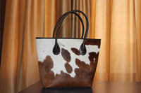 vintage cowhide purse brown and white