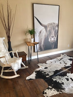 These cowhide rugs are very soft/pliable and not stiff at all which makes these great for upholstery, draped over furniture or even wall decor.