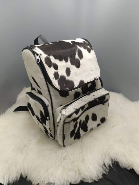 Pretty cowhide travel bag that can be used for school or even shopping, ships quickly and can be made in mommy bag style.