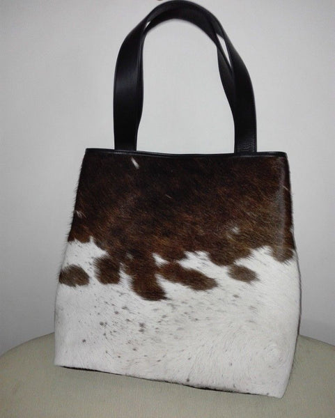 Beautiful brown and white cowhide purse