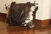 hair on cowhide messenger bag