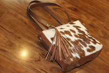 brown and white cowhide bag custom made