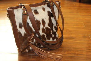 one of its kind brown and white cowhide shoulder bag