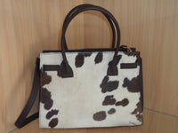 Brown And White Cowhide Rode Bag for your day out