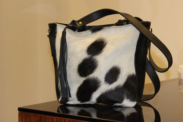 Natural Cowhide Messenger Bag in black and white