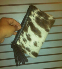 brown and white cowhide bag