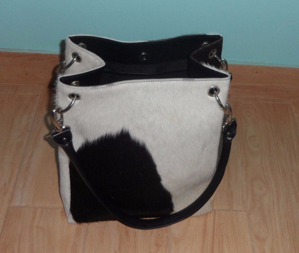 I bought this cowhide leather bag as a 3 year anniversary gift for my wife It came quickly and was exactly as described.