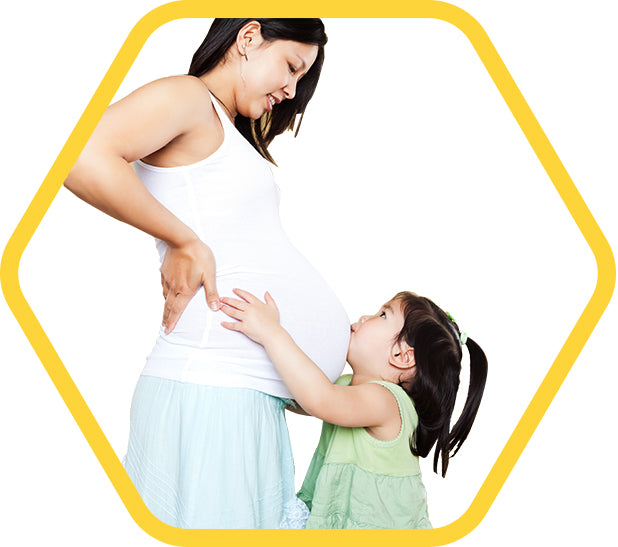 A girl kissing her pregnant mummy's tummy - a hexagonal logo