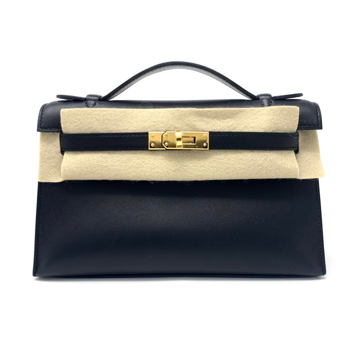 Hermes Kelly Pochette mini noir black swift leather Designer Consignment From Runway With Love