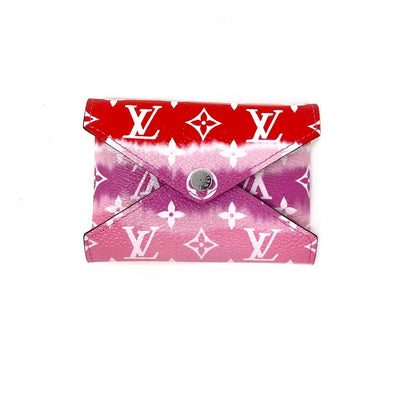 Louis Vuitton Escale Pochette Kirigami Limited edition Giant monogram red rouge consignment shop from runway with love