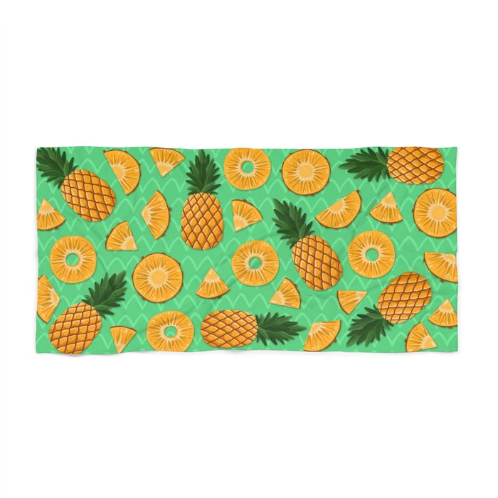 30 x 60 green beach towel with images of pineapples