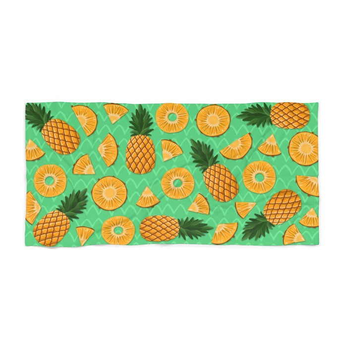 36 x 72 green beach towel with images of pineapples