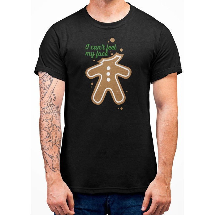 Black color t-shirt with green text I Can't Feel My Face and image of ginger bread with no head