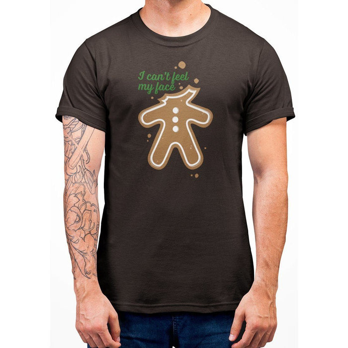 Brown color t-shirt with green text I Can't Feel My Face and image of ginger bread with no head