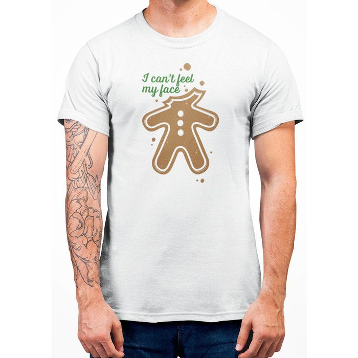 White color t-shirt with green text I Can't Feel My Face and image of ginger bread with no head