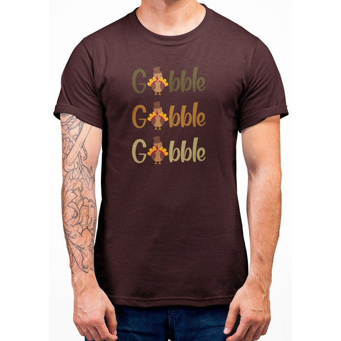 Maroon t-shirt that says gobble gobble goblle with turkeys on it