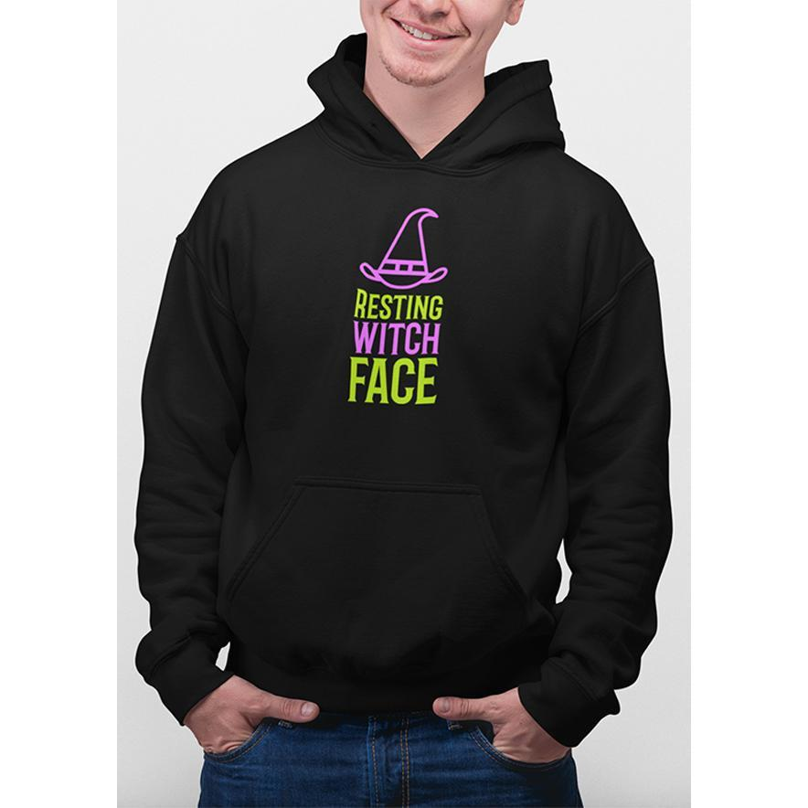 Black hoodie with purple and green text resting witch face