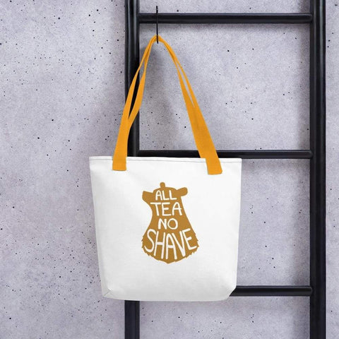 White 15 x 15 weather resistant fabric tote bag with gold straps and gold brown bear image