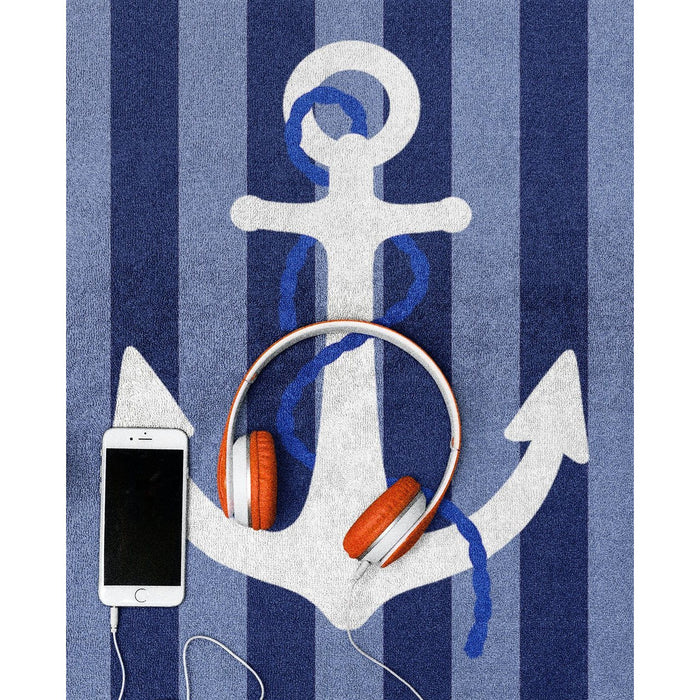 Close of blue striped beach towel with white anchor
