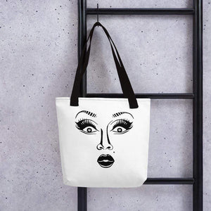 White 15 x 15 weather resistant fabric tote bag with black straps and drag queen face image