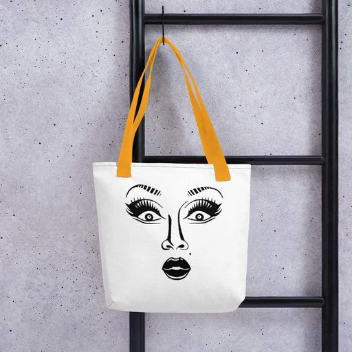 White 15 x 15 weather resistant fabric tote bag with gold straps and drag queen face image