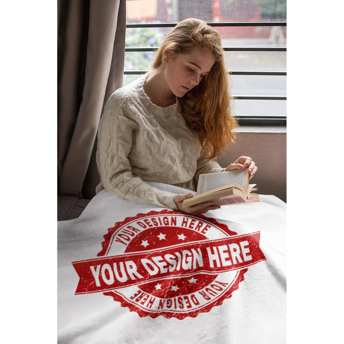 ledy reading book in a personlized fleece blanker