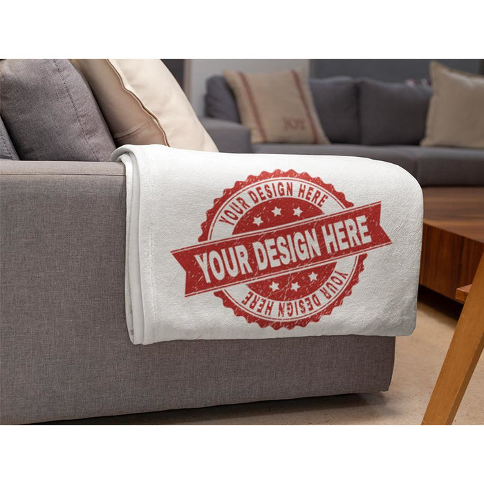 Personalizef fleece blanket haning over a sofa