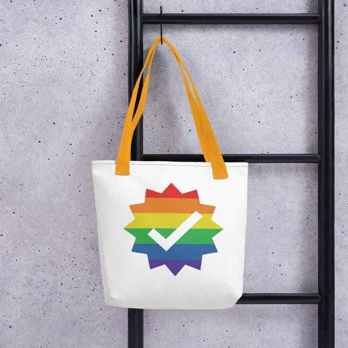 White 15 x 15 weather resistant fabric tote bag with gold straps and rainbow checkmark image